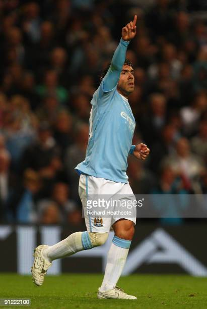 Carlos Tevez of Manchester City celebrates scoring his team's third goal during the Barclays Premier League match between Manchester City and West...