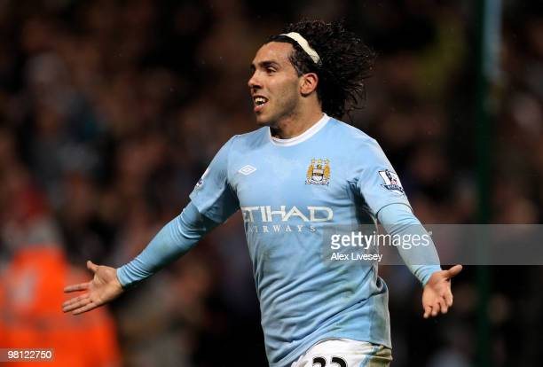 Carlos Tevez of Manchester City celebrates scoring his team's third goal and his hat trick during the Barclays Premier League match between...