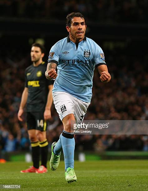 Carlos Tevez of Manchester City celebrates scoring the opening goal during the Barclays Premier League match between Manchester City and Wigan...
