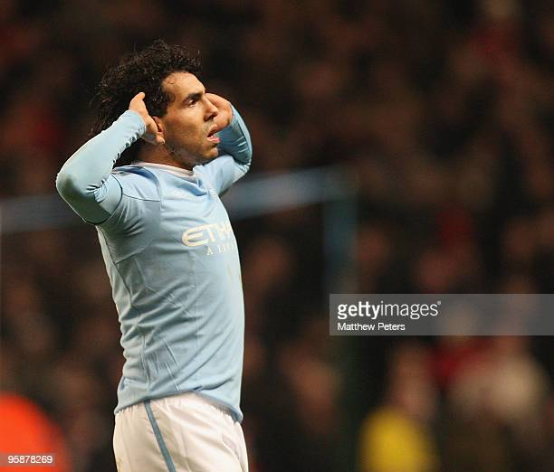 Carlos Tevez of Manchester City celebrates scoring their second goal the Carling Cup Semi-Final First Leg match between Manchester City and...
