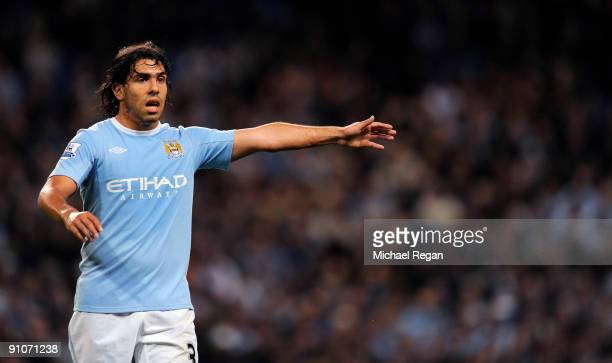 Carlos Tevez of Manchester City gestures during the Carling Cup third round match between Manchester City and Fulham at the City of Manchester...
