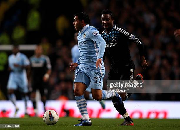 Carlos Tevez of Manchester City is pursued by John Obi Mikel of Chelsea during the Barclays Premier League match between Manchester City and Chelsea...