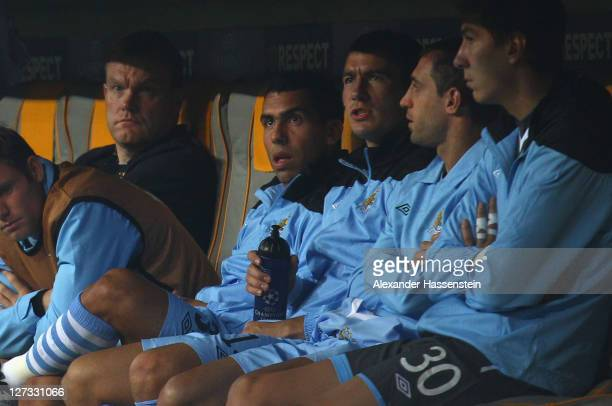 Carlos Tevez of Manchester City looks on from the bench during the UEFA Champions League group A match between FC Bayern Muenchen and Manchester City...