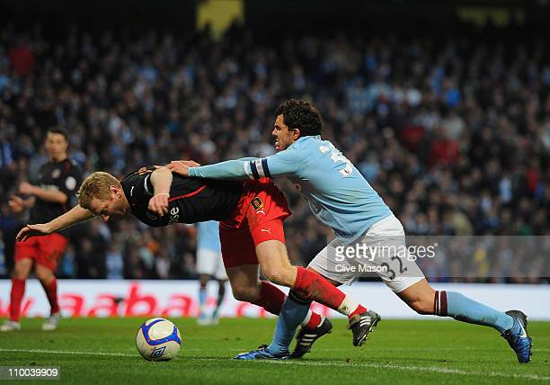 Carlos Tevez Of Manchester City Pushes Brynjar Gunnarsson Of Reading During The Fa Cup Sponsored By