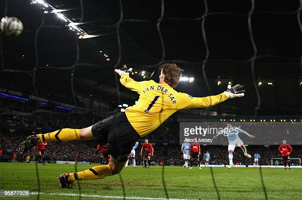 Carlos Tevez of Manchester City scores his team's first goal past Edwin Van der Sar of Manchester United during the Carling Cup Semi Final match...