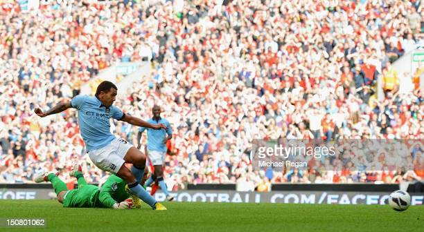 Carlos Tevez of Manchester City scores his team's second goal during the Barclays Premier League match between Liverpool and Manchester City at...