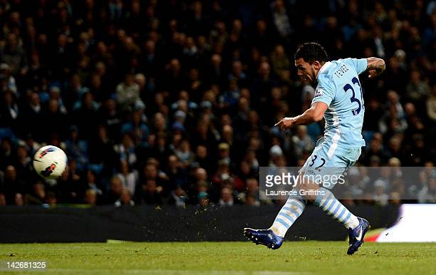Carlos Tevez of Manchester City scores his team's third goal during the Barclays Premier League match between Manchester City and West Bromwich...