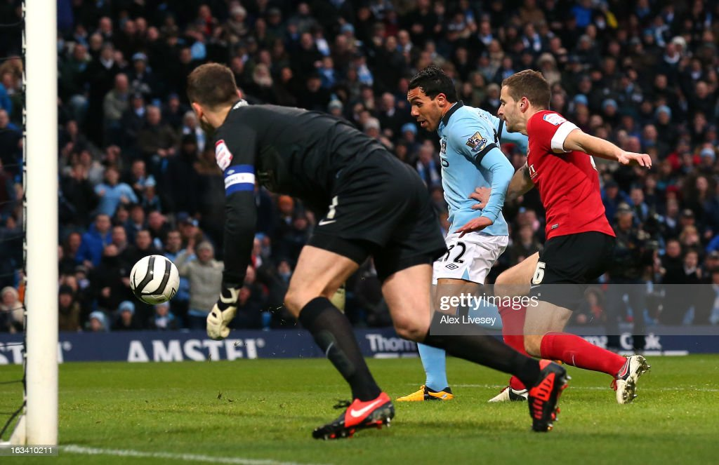 Carlos Tevez of Manchester City scores the opening goal during the FA Cup sponsored by Budweiser sixth round match between Manchester City and Barnsley at Etihad Stadium on March 9, 2013 in Manchester, England.