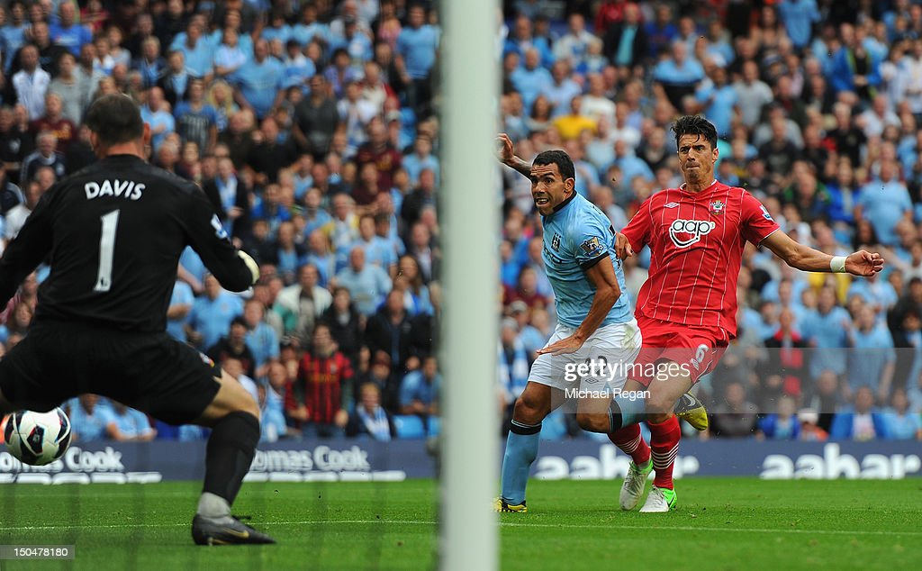 Carlos Tevez of Manchester City scores the opening goal during the Barclays Premier League match between Manchester City and Southampton at Etihad Stadium on August 19, 2012 in Manchester, England.