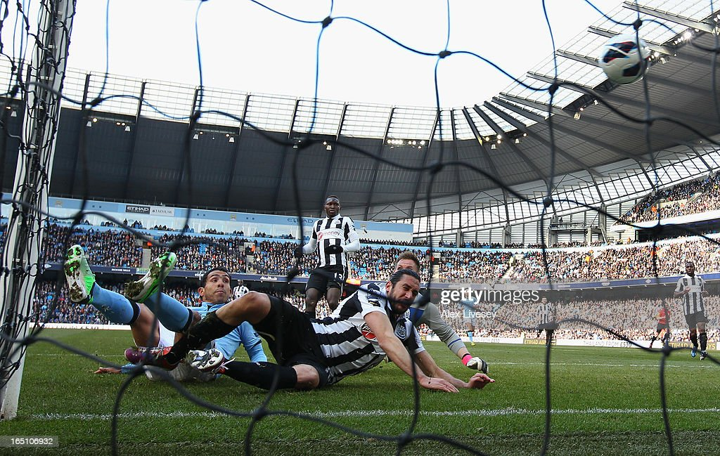 Carlos Tevez of Manchester City scores the opening goal during the Barclays Premier League match between Manchester City and Newcastle United at the Etihad Stadium on March 30, 2013 in Manchester, England.