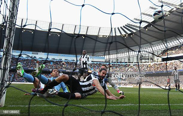 Carlos Tevez of Manchester City scores the opening goal during the Barclays Premier League match between Manchester City and Newcastle United at the...