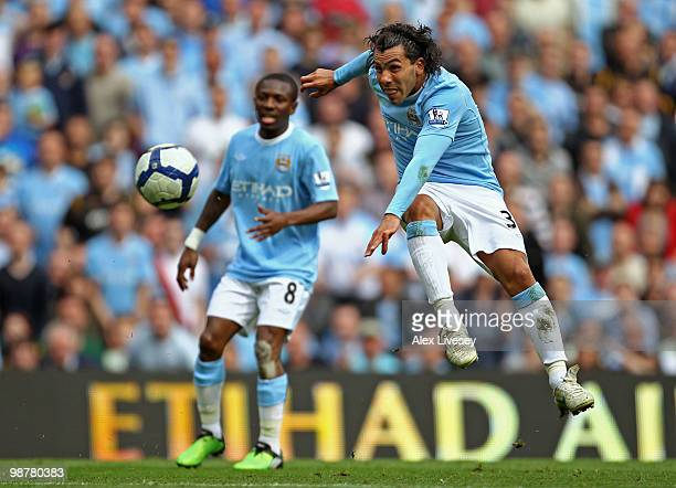 Carlos Tevez of Manchester City takes a shot on goal during the Barclays Premier League match between Manchester City and Aston Villa at the City of...