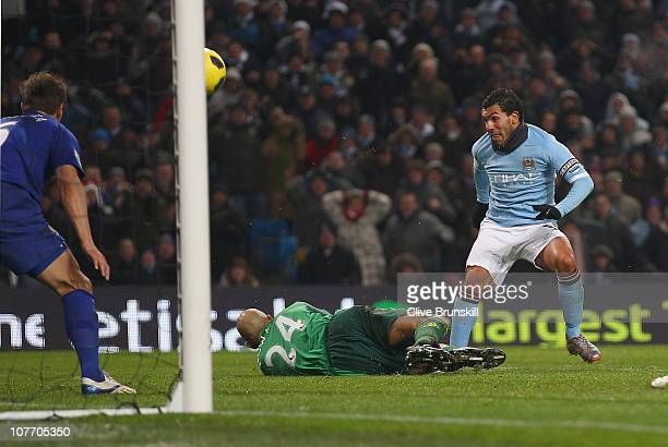 Carlos Tevez of Manchester City watches as his close range shot is saved by Tim Howard of Everton during the Barclays Premier League match between...