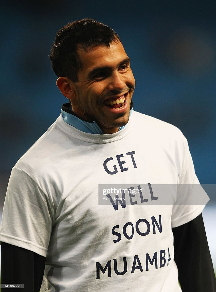 Carlos Tevez of Manchester City wears a t-shirt in support of Fabrice Muamba as he warms up prior to during the Barclays Premier League match between Manchester City and Chelsea at the Etihad Stadium on March 21, 2012 in Manchester, England.