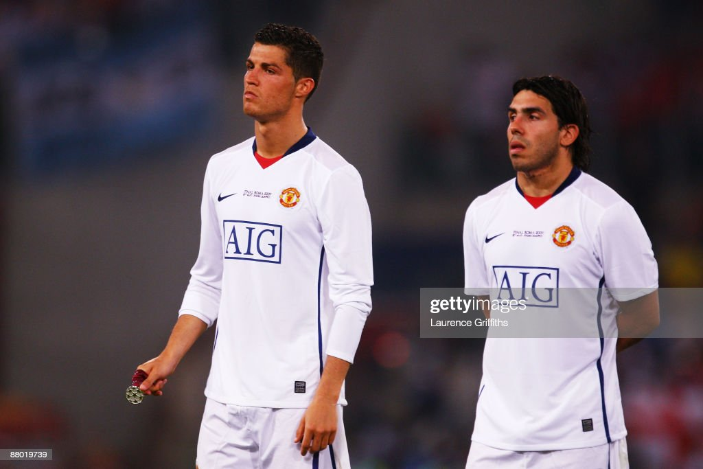 Carlos Tevez of Manchester United and Cristiano Ronaldo of Manchester United look dejected after Barcelona won the UEFA Champions League Final match between Barcelona and Manchester United at the Stadio Olimpico on May 27, 2009 in Rome, Italy. Barcelona won 2-0.