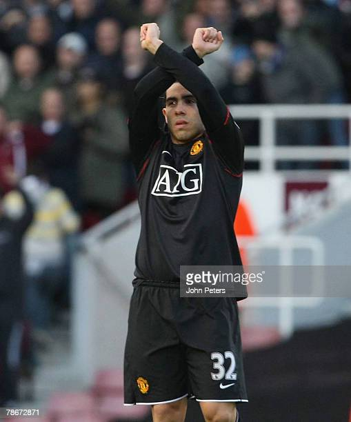 Carlos Tevez of Manchester United applauds the home fans during the Barclays FA Premier League match between West Ham United and Manchester United at...