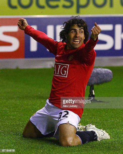 Carlos Tevez of Manchester United celebrates after scoring the equalizing goal during the Barclays Premier League match between Wigan Athletic and...