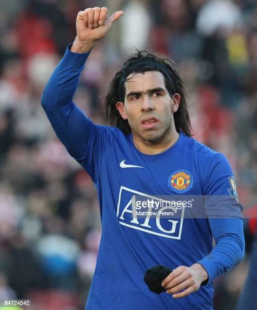 Carlos Tevez of Manchester United celebrates at the end of the Barclays Premier League match between Stoke City and Manchester United at the...