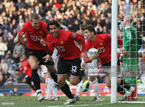 Carlos Tevez of Manchester United celebrates scoring the equalizing goal during the Barclays FA Premier League match between Blackburn Rovers and...