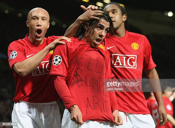 Carlos Tevez of Manchester United celebrates scoring their first goal during the UEFA Champions League QuarterFinal second leg match between...
