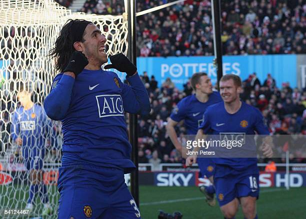 Carlos Tevez of Manchester United celebrates scoring their first goal during the Barclays Premier League match between Stoke City and Manchester...