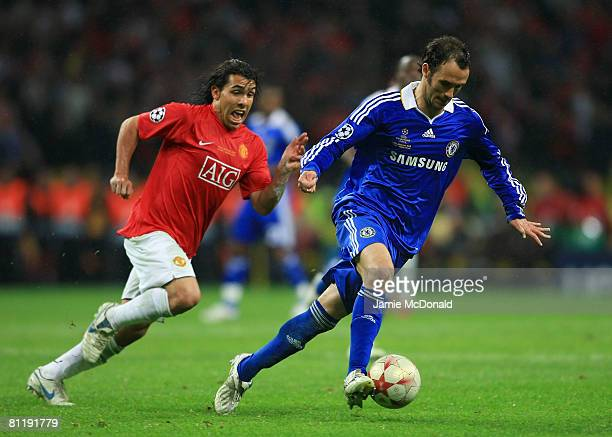 Carlos Tevez of Manchester United chases Ricardo Carvalho of Chelsea during the UEFA Champions League Final match between Manchester United and...