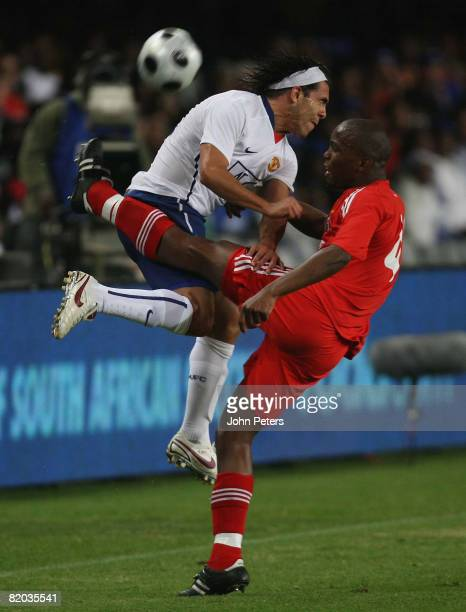 Carlos Tevez of Manchester United clashes with Bennet Chenene of Orlando Pirates during the Vodacom Challenge preseason friendly match between...