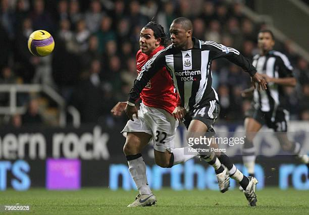 Carlos Tevez of Manchester United clashes with Charles N'Zogbia of Newcastle United during the Barclays FA Premier League match between Newcastle...