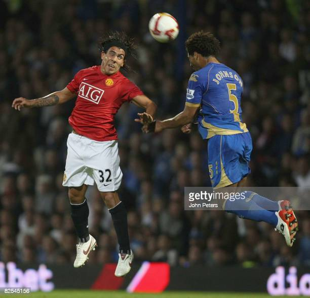 Carlos Tevez of Manchester United clashes with Glen Johnson of Portsmouth during the FA Premier League match between Portsmouth and Manchester United...