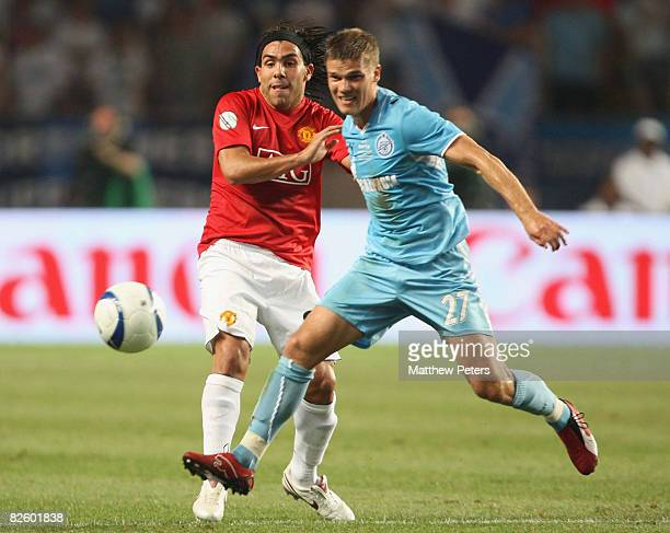 Carlos Tevez of Manchester United clashes with Igor Denisov of Zenit St Petersburg during the UEFA Supercup match between Manchester United and Zenit...