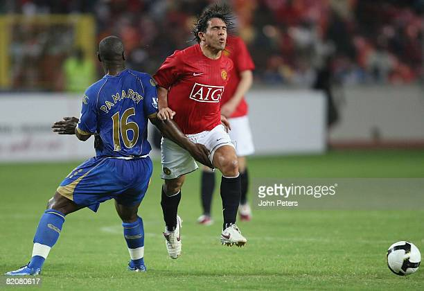 Carlos Tevez of Manchester United clashes with Noe Pamarot of Portsmouth during the preseason friendly match between Manchester United and Portsmouth...