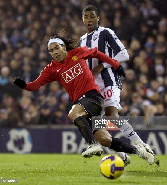 Carlos Tevez of Manchester United clashes with Ryan Donk of West Bromwich Albion during the Barclays Premier League match between West Bromwich...