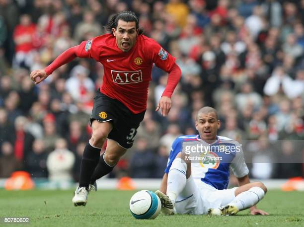 Carlos Tevez of Manchester United clashes with Steven Reid of Blackburn Rovers during the Barclays FA Premier League match between Blackburn Rovers...