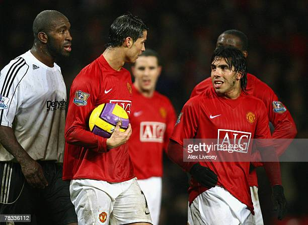 Carlos Tevez of Manchester United is denied the chance to complete his hat trick as team mate Cristiano Ronaldo claims the ball to take a penalty...