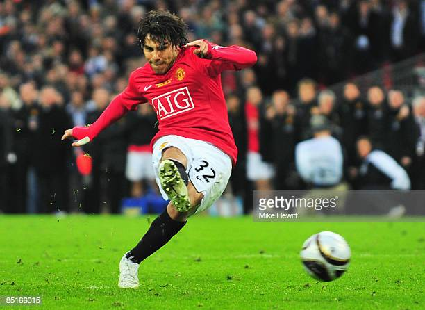 Carlos Tevez of Manchester United scores a penalty in the shoot out during the Carling Cup Final match between Manchester United and Tottenham...