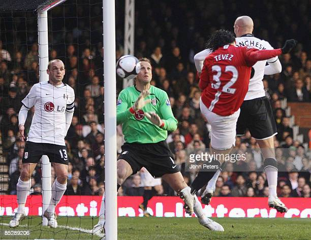 Carlos Tevez of Manchester United scores the first goal past Fulham goalkeeper Mark Schwarzer during the FA Cup sponsored by e.on Sixth Round match...