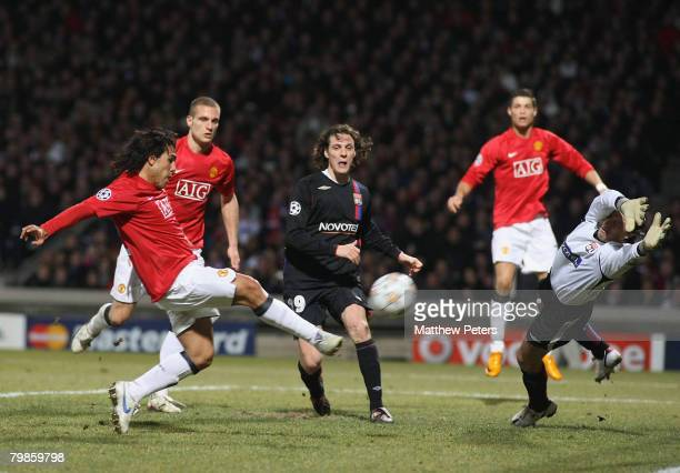 Carlos Tevez of Manchester United scores their first goal the UEFA Champions League first knockout round match between Olympique Lyonnais and...