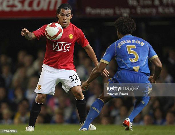 Carlos Tevez of Manchester United takes on Glen Johnson of Portsmouth during the FA Premier League match between Portsmouth and Manchester United at...