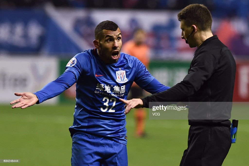 Carlos Tevez #32 of Shanghai Shenhua argues with the referee Valentin Kovalenko during the AFC Champions League 2017 play-off match between Shanghai Shenhua and Brisbane Roar at Hongkou Stadium on February 8, 2017 in Shanghai, China.