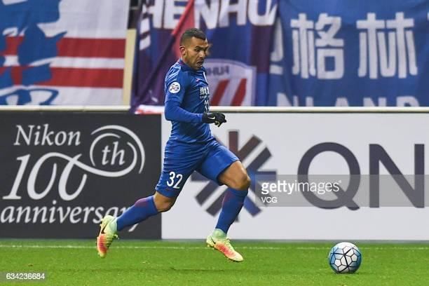 Carlos Tevez of Shanghai Shenhua drives the ball during the AFC Champions League 2017 playoff match between Shanghai Shenhua and Brisbane Roar at...