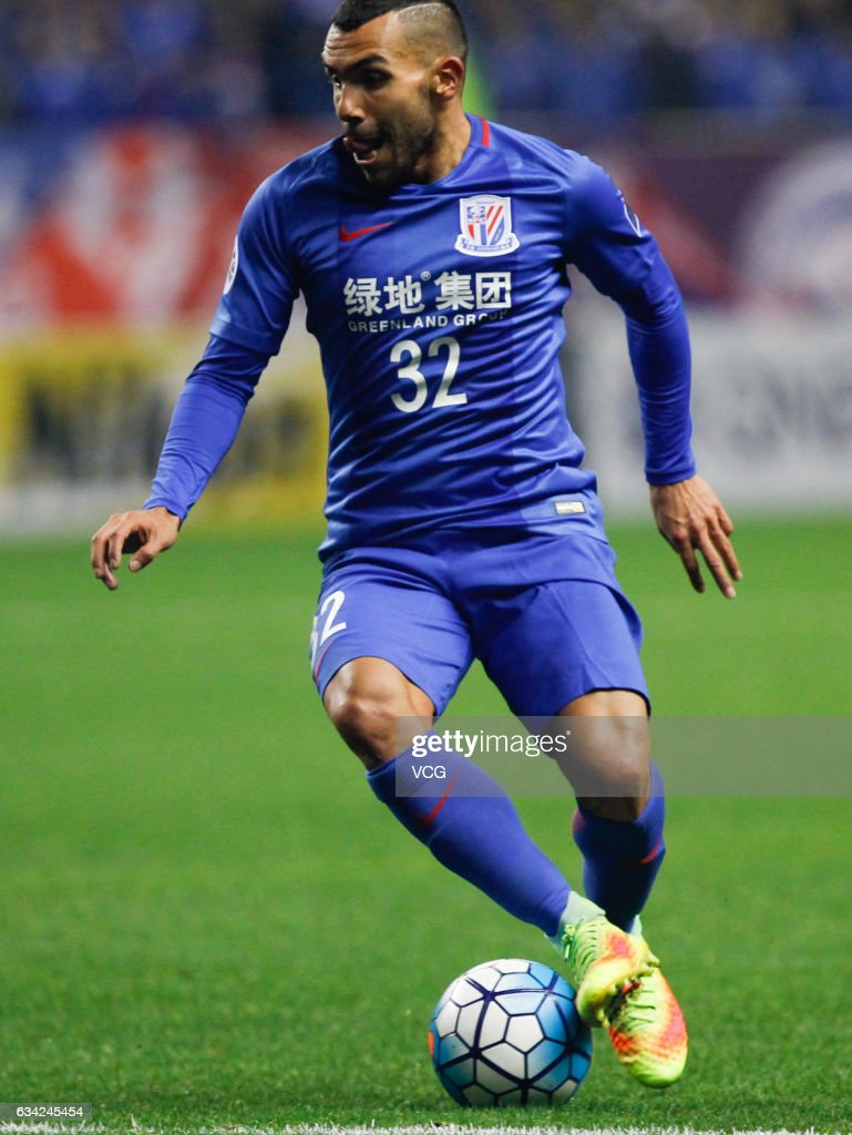 Carlos Tevez #32 of Shanghai Shenhua drives the ball during the AFC Champions League 2017 play-off match between Shanghai Shenhua and Brisbane Roar at Hongkou Stadium on February 8, 2017 in Shanghai, China.