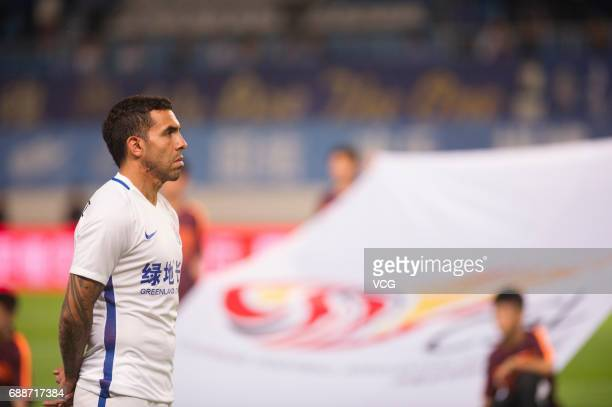 Carlos Tevez of Shanghai Shenhua looks on prior to the 11th round match of China Super League between Guangzhou RF and Shanghai Shenhua at Yuexiushan...