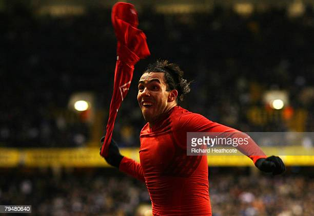 Carlos Tevez of United celebrates the equalising goal of Tottenham during the Barclays Premier League match between Tottenham Hotspur and Manchester...