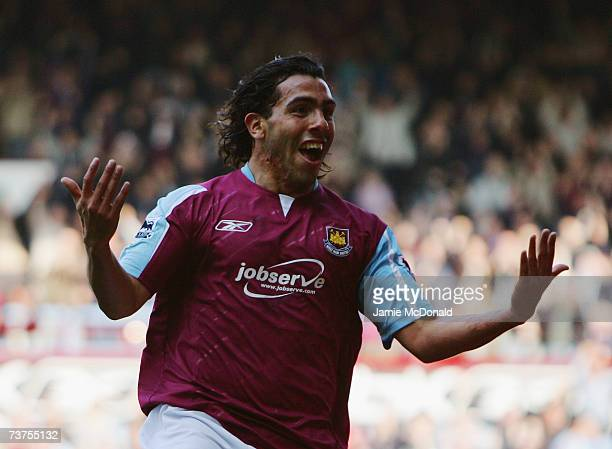 Carlos Tevez of West Ham celebrates after scoring his team's second goal during the Barclays Premiership match between West Ham United and...