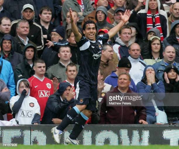 Carlos Tevez of West Ham United celebrates scoring their first goal during the Barclays Premiership match between Manchester United and West Ham at...