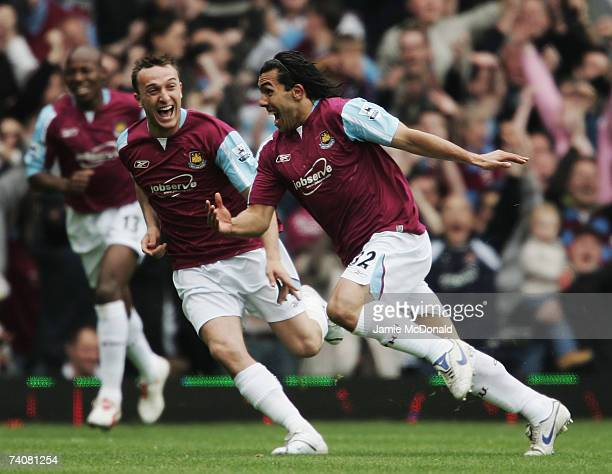 Carlos Tevez of West Ham United celebrates scoring with team mate Mark Noble during the Barclays Premiership match between West Ham United and Bolton...