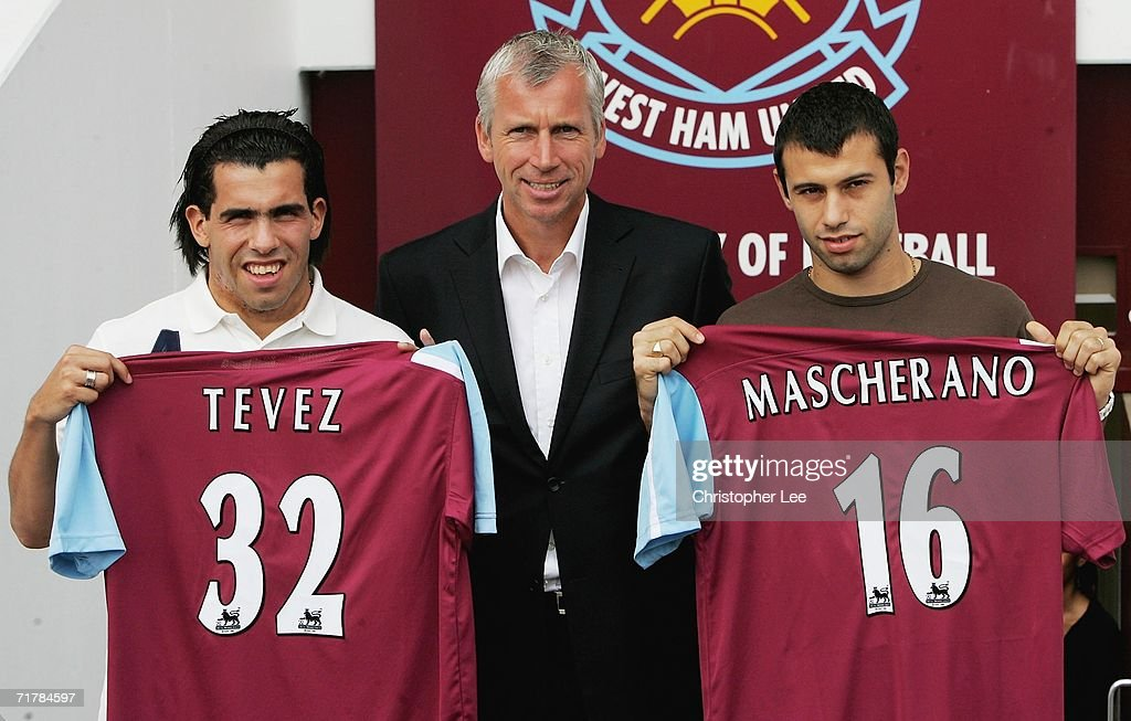 Carlos Tevez, West Ham manager Alan Pardew and Javier Mascherano pose with their squad numbers during a West Ham United press conference to unveil the new signings at Upton Park on September 5, 2006 in London, England.