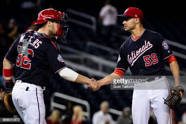 Carlos Torres and Matt Wieters of the Washington Nationals celebrate after the game against the Pittsburgh Pirates at Nationals Park on May 1 2018 in...