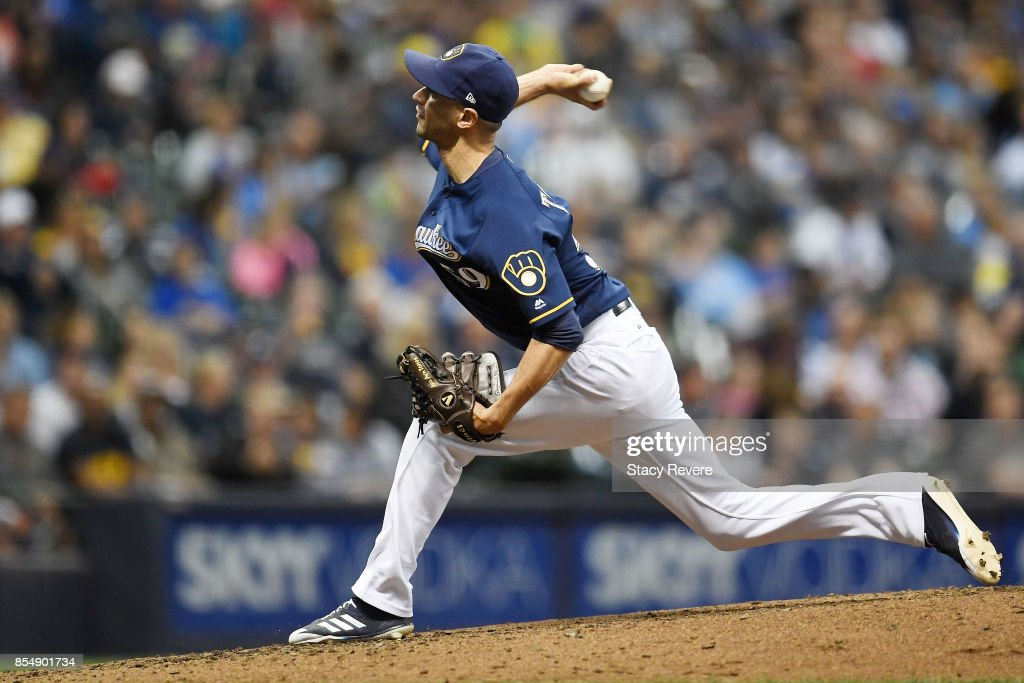 Carlos Torres #59 of the Milwaukee Brewers throws a pitch during the third inning of a game against the Cincinnati Reds at Miller Park on September 27, 2017 in Milwaukee, Wisconsin.