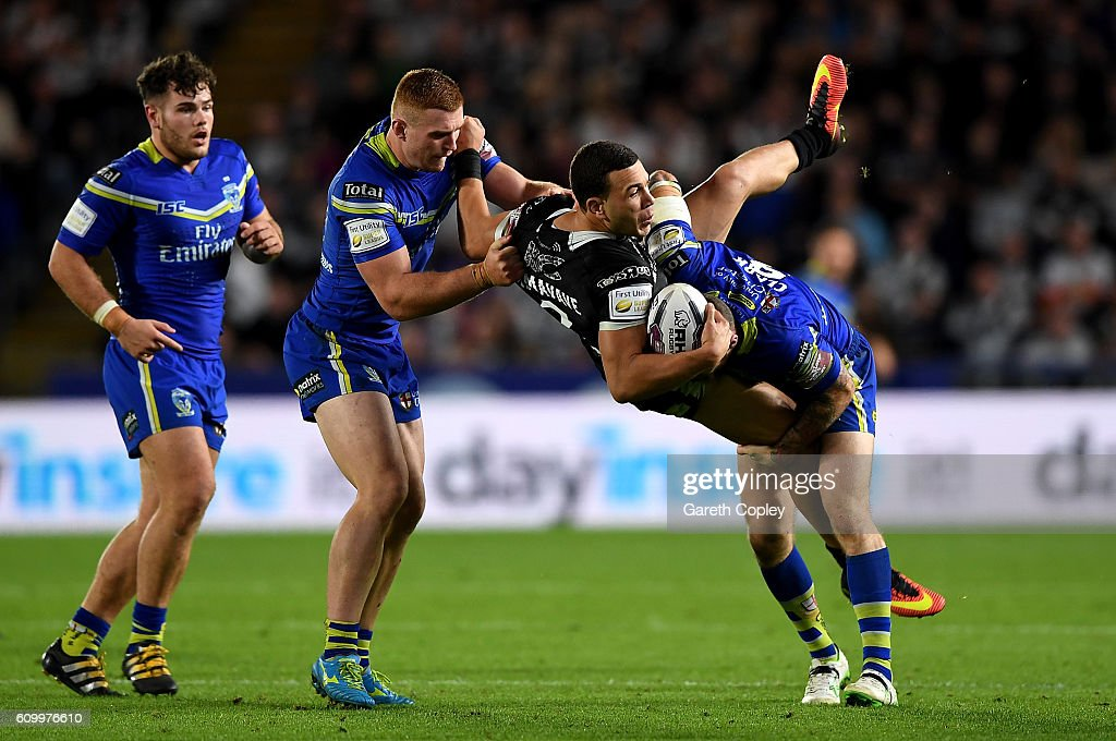 Carlos Tuimavave of Hull is tackled by Daryl Clark of Warrington during the First Utility Super League match between Hull FC and Warrington Wolves at KCOM Stadium on September 23, 2016 in Hull, England.